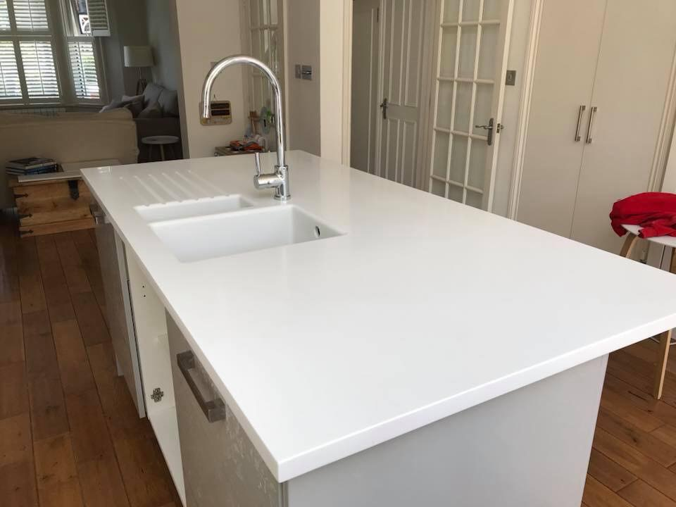Stunning light ash corian kitchen worksurface island