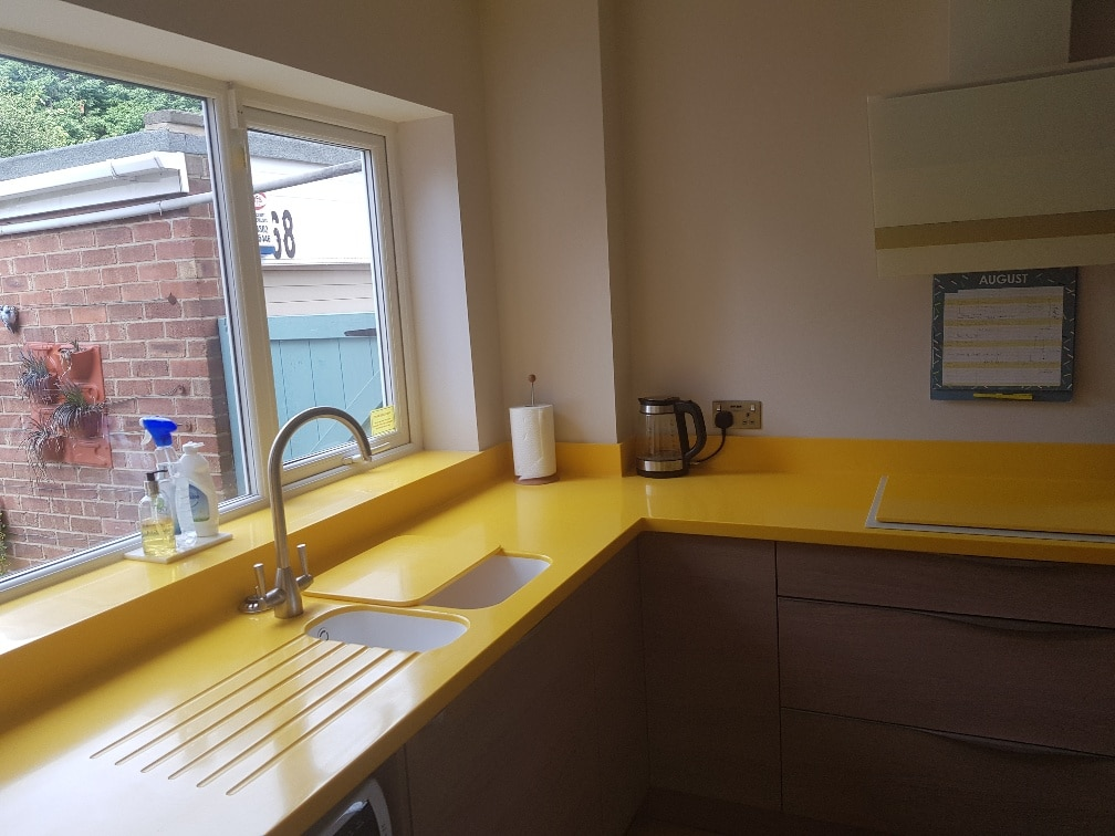 Corian worktops in Inperial Yellow